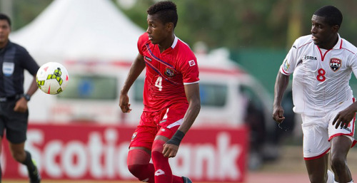 Photo: Trinidad and Tobago midfielder Neveal Hackshaw (right) keeps an eye on Panama right back Michael Murillo in CONCACAF Under-20 Championship action on Sunday. (Courtesy CONCACAF)