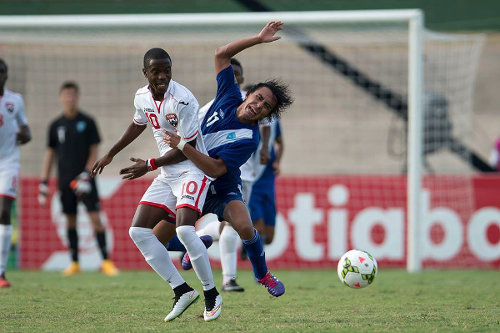 Photo: Trinidad and Tobago National Under-20 midfielder Jabari Mitchell (left) tangles with Guatemala attacker Mario Hernandez during CONCACAF action in Jamaica. (Courtesy CONCACAF)