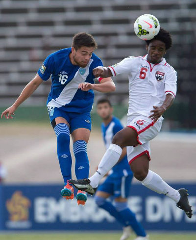 Photo: Trinidad and Tobago's Duane Muckette (right) challenges Guatemala captain Julio Ortiz during the CONCACAF Under-20 Championship. (Courtesy CONCACAF)