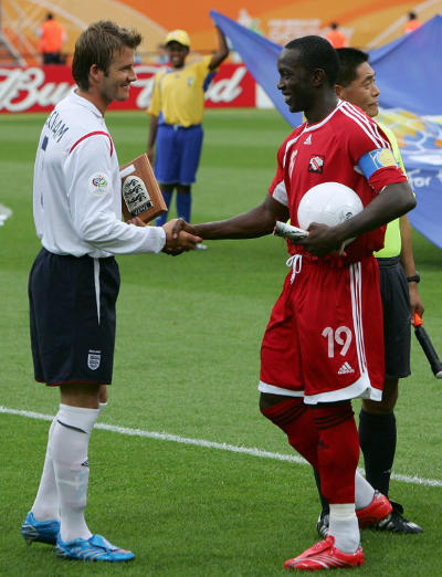 Photo: Ex-Trinidad and Tobago captain Dwight Yorke (right) greets England captain David Beckham during the Germany 2006 World Cup. (Copyright AFP 2015)