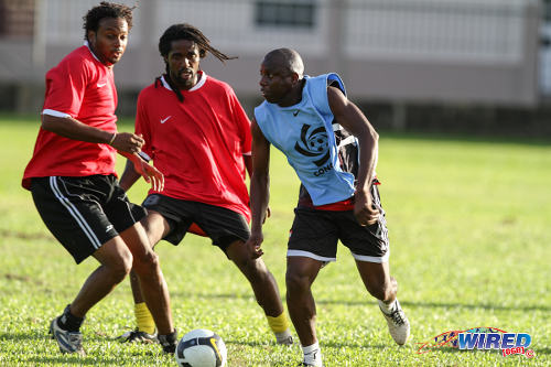"Photo: Former ""Strike Squad"" star Hutson ""Barber"" Charles (right) takes on the Mango XI during the inaugural Wired868 Football Festival in 2013. (Courtesy Allan V Crane/Wired868)"