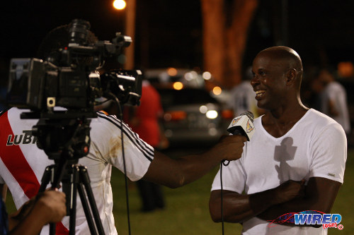 Photo: Former Strike Squad star Leonson Lewis (right) talks to the media after the 2014 Wired868 Football Festival in UWI. (Courtesy Allan V Crane/Wired868)