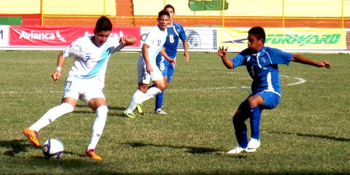 Photo: Guatemala National Under-17 attacker Esteban Garcia (left) takes on an El Salvador opponent during a Central American qualifier. (Courtesy CONCACAF)