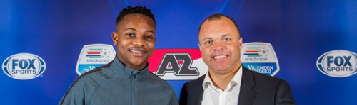 Photo: AZ Alkmaar technical director Earnie Stewart (right) welcomes 17-year-old Trinidad and Tobago winger Levi Garcia. (Courtesy AZ Alkmaar)