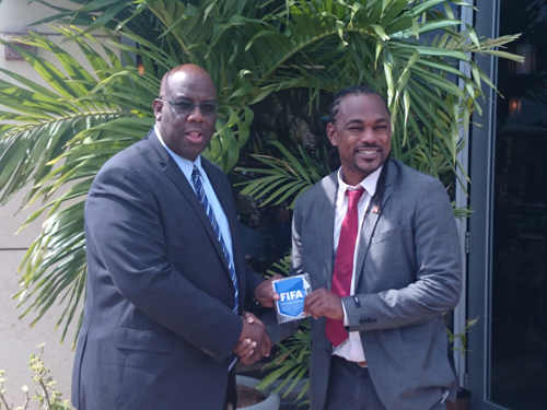 Photo: Trinidad and Tobago Sport Minister Brent Sancho (right) and FIFA Development Officer Howard McIntosh exchange pleasantries. (Courtesy TTFA Media)