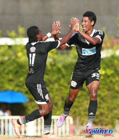Photo: Central FC scorer Willis Plaza (right) is congratulated by teammate Darren Mitchell during Pro League action against Point Fortin Civic. (Courtesy Allan V Crane/Wired868)