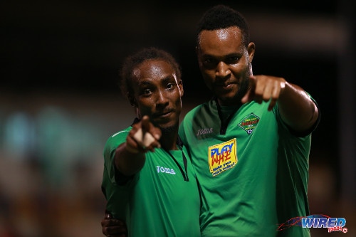 Photo: San Juan Jabloteh scorer Tyrone Charles (left) celebrates his goal against Caledonia AIA with teammate Sterling Newton. (Courtesy Allan V Crane/Wired868)