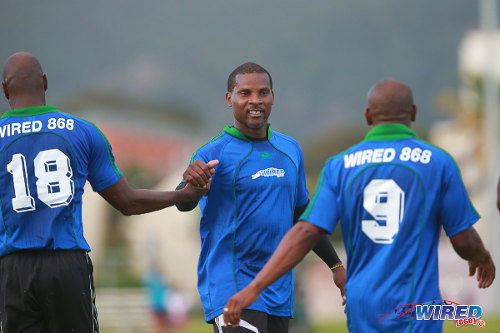 Photo: Former Trinidad and Tobago international stand-out and Point Fortin Civic coach Reynold Carrington (centre) exchanges greetings with Leonson Lewis (left) and ex-W Connection teammate and St Lucia international star Earl Jean. (Courtesy Allan V Crane/Wired868)