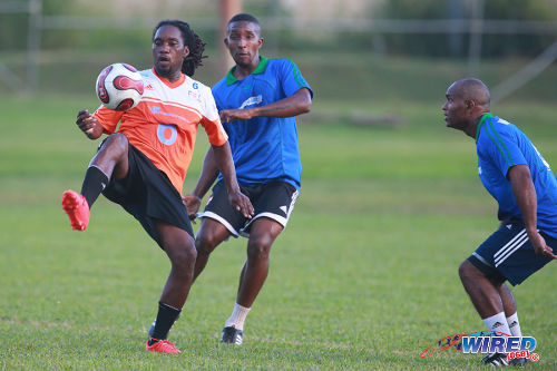 Photo: Former Trinidad and Tobago senior international utility player Nigel Daniel (left) takes on former national youth players Chris Durity (centre) and Roger Henry during the third annual Wired868 Football Festival. (Courtesy Allan V Crane/Wired868)