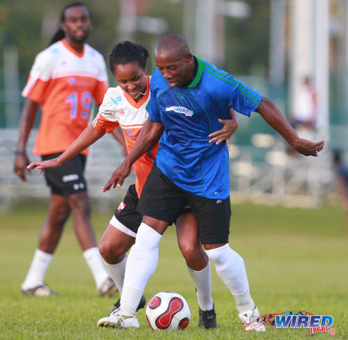 Photo: Trinidad and Tobago national women's team captain Maylee Attin-Johnson met her match with ex-W Connection stand-out Earl Jean at the 2015 Wired868 Football Festival at UWI SPEC. (Courtesy Allan V Crane/Wired868)