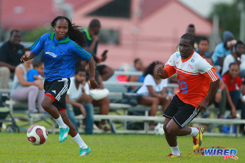 Photo: Trinidad and Tobago national women's team winger Ahkeela Mollon (left) takes former national youth team midfielder Lorne Joseph for a run during the 2015 Wired868 Football Festival at the UWI SPEC ground in St Augustine. (Courtesy Allan V Crane/Wired868)