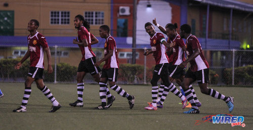 Photo: North East Stars players celebrate a TTFA FA Trophy goal against Defence Force. (Courtesy Sinead Peters/Wired868)