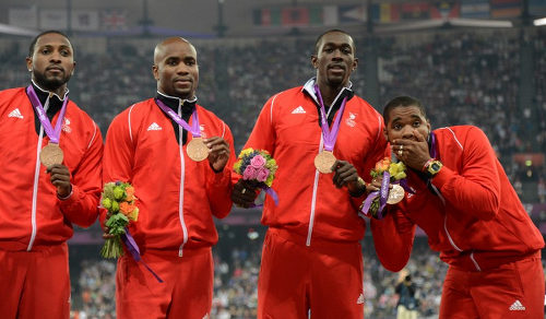 Photo: Trinidad and Tobago sprinters (from left) Richard Thompson, Emmanuel Callender, Marc Burns and Keston Bledman finished third at the London 2012 Olympic Games. However, they are due silver medals after US sprinter Tyson Gay subsequently failed a dope test. (Courtesy AFP 2015)