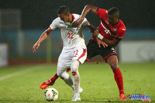 Photo: Trinidad and Tobago defender Sheldon Bateau (right) tries to wrestle the ball from Panama attacker Rolando Escobar during last night's friendly international at the Ato Boldon Stadium, Couva. (Courtesy Allan V Crane/Wired868)