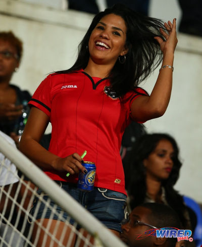 Photo: A Soca Warriors fan enjoys the action between Trinidad and Tobago and Panama at the Ato Boldon Stadium, Couva on 27 March 2015. (Courtesy Allan V Crane/Wired868)