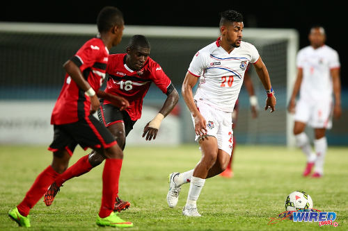 Photo: Trinidad and Tobago teenagers Neveal Hackshaw (centre) and Shannon Gomez (left) track down Panama playmaker Anibal Godoy during international action at the Ato Boldon Stadium, Couva. (Courtesy Allan V Crane/Wired868)