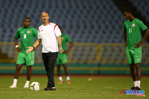 Photo: Trinidad and Tobago head coach Stephen Hart (centre) makes a point while midfielders Ataulla Guerra (right) and Khaleem Hyland look on during a practice session in March. (Courtesy Allan V Crane/Wired868)