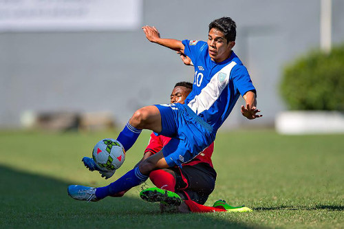 Photo: Trinidad and Tobago National Under-17 left back Keston Julien (background) tackles Guatemala attacker John Mendez during CONCACAF action. (Courtesy MexSport/CONCACAF)