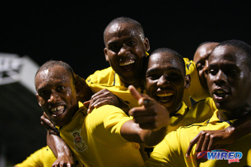 Photo: Defence Force winger Jemel Sebro (far left) celebrates his strike against W Connection with Devorn Jorsling (far right) and teammates at the Marvin Lee Stadium. (Courtesy Allan V Crane/Wired868)