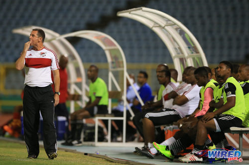 Photo: Central FC coach Terry Fenwick (left) whistles from the bench during his team's contest with Point Fortin Civic. (Courtesy Allan V Crane/Wired868)