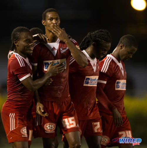 Photo: Central FC attacker Ataulla Guerra (second from left) gestures to the crowd during a Pro League match against San Juan Jabloteh. From left are teammates Darren Mitchell, Jason Marcano and Kevon Villaroel. (Courtesy Allan V Crane/Wired868)