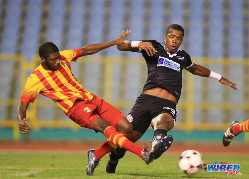 Photo: Point Fortin Civic right back Steven Joseph (left) tackles then Central FC forward Dwight Quintero in the 2014/15 Pro League season. (Courtesy Allan V Crane/Wired868)