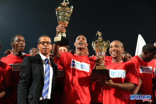 Photo: Central FC captain Leston Paul (right) holds the Akeem Adams trophy for winning the final round. Teammate Ataulla Guerra (centre) lifts the Pro League trophy while league CEO Dexter Skeene looks on. (Courtesy Alllan V Crane/Wired868)