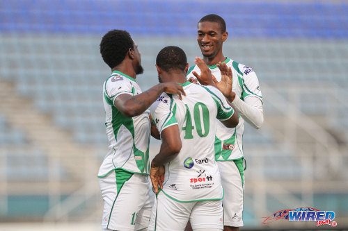 Photo: W Connection hattrick hero Hashim Arcia (right) is congratulated by teammates Jomal Williams (centre) and Jerrel Britto during their 7-2 win over SAP FC in the Caribbean Club Championship. (Courtesy Sinead Peters/Wired868)