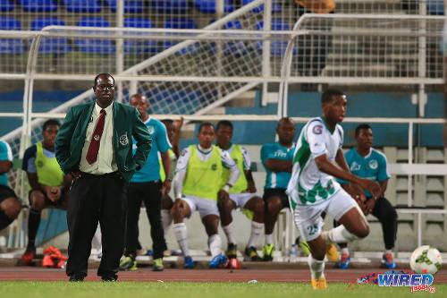 Photo: W Connection coach Stuart Charles-Fevrier (left) looks on while winger Aikim Andrews (right) runs with the ball during the 2015 TTFA FA Trophy final. (Courtesy Allan V Crane/Wired868)