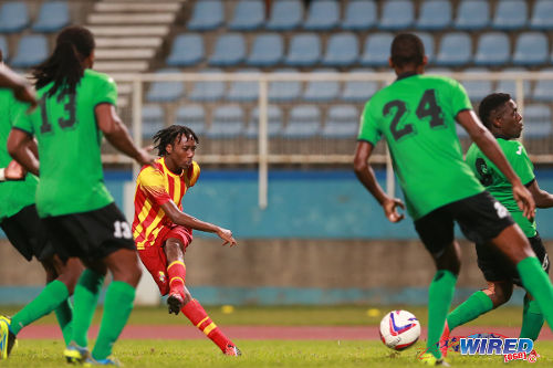 Photo: Point Fortin Civic midfielder Akeem Redhead (centre) shoots for goal in the 2014 Toyota Classic final against San Juan Jabloteh. (Photo: Allan V Crane/Wired868)