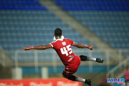 Photo: Central FC attacking midfielder Ataulla Guerra tries a spectacular volley in a 2014/15 Pro League encounter against Police FC. (Courtesy Allan V Crane/Wired868)