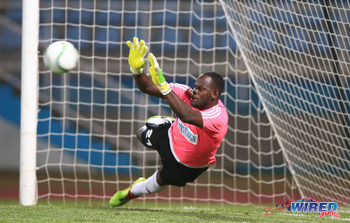 Photo: Central FC goalkeeper Jan-Michael Williams makes one of three penalty saves against Montego Bay United FC in the Caribbean Club Championship semifinals. Central won 3-1 on kicks from the penalty mark. (Courtesy Allan V Crane/Wired868)
