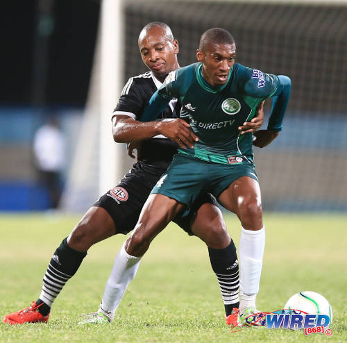 Photo: Central FC midfielder Leston Paul (left) tries to keep a grip on W Connection playmaker Hashim Arcia during the 2015 Caribbean Club Championship final. (Courtesy Allan V Crane/Wired868)