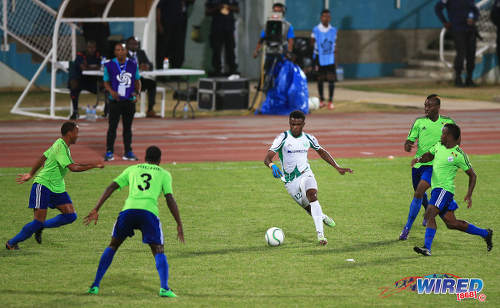 Photo: W Connection attacker Jerrel Britto (centre) occupies four Montego Bay FC defenders during the 2015 Caribbean Club Championship semifinal. Looking on is Connection assistant coach Earl Jean. (Courtesy Allan V Crane/Wired868)