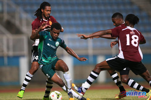 Photo: North East Stars defender Dwane James (far left) prepares to haul back W Connection striker Jerrel Britto (second from left) while Stars players Kaashif Thomas (far right) and Keryn Navarro look on. (Courtesy Allan V Crane/Wired868)