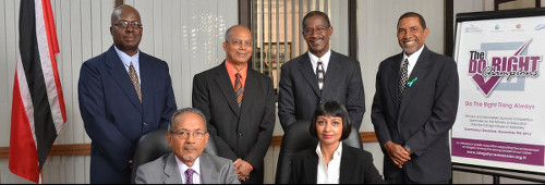 Photo: Dr Shelly Anne Lalchan (front row, right) sits alongside Integrity Commission chairman Justice Zainool Hosein and the rest of the team. (Courtesy Integrity Commission)
