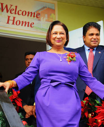 Photo: Can't touch this! Opposition Leader Kamla Persad-Bissessar (left) strikes a pose with rival, Dr Roodal Moonilal, in tow.