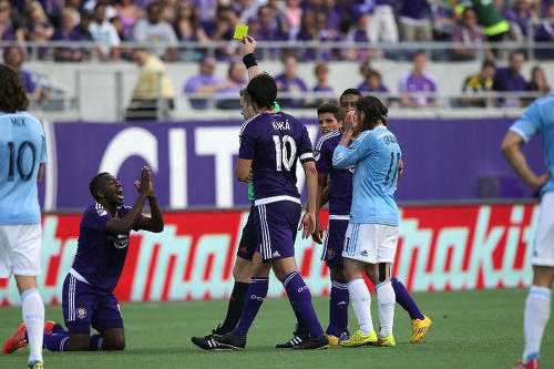 Photo: Orlando City SC midfielder Kevin Molino (second from leg) pleads his case to the match official during a MLS clash with New York City FC. Looking on (third from left) is Orlando attacker and former FIFA Player of the Year, Kaka. (Copyright Alex Menendez/AFP 2015)