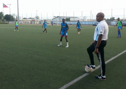 Photo: Coach Jason Spence (far right) leads the St Ann's Rangers team at a training session.