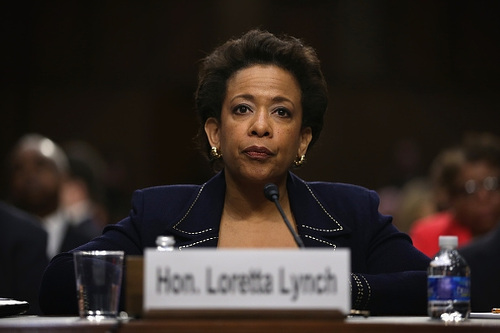 Photo: United States Attorney General Loretta E Lynch seems decidedly unlikely to fall for Jack Warner's charms.