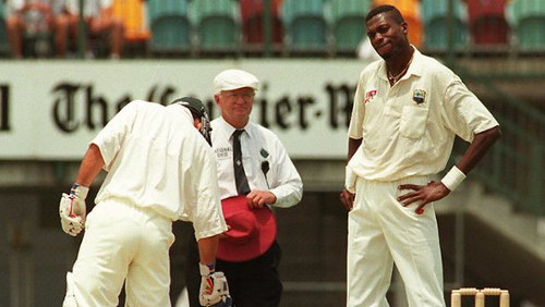 Photo: West Indies cricket legend Curtly Ambrose (right) glares at Australia batsman Ricky Ponting.