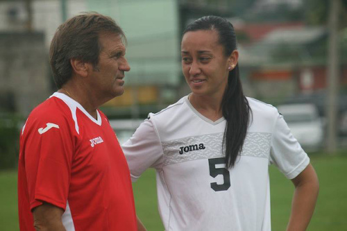 "Photo: Former ""Women's Soca Warriors"" head coach Randy Waldrum (left) talks to Trinidad and Tobago defender Arin King. (Courtesy TTFA Media)"