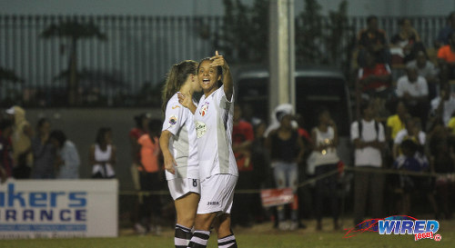 Photo: Angels captain Maylee Attin-Johnson (right) gestures as teammate Rafaela De Vargas looks on, during their 3-0 opening WPL win over Wave. (Courtesy Sinead Peters/Wired868)