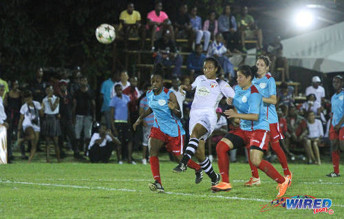Photo: Angels captain Maylee Attin-Johnson (centre) scores a fine opener against Wave. (Courtesy Sinead Peters/Wired868)