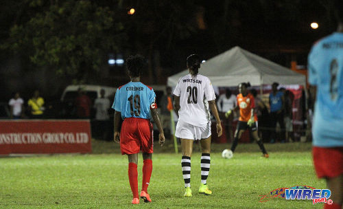 Photo: Angels midfielder Tamar Watson (right) stays close to Wave attacker and captain Kennya Cordner. (Courtesy Sinead Peters/Wired868)