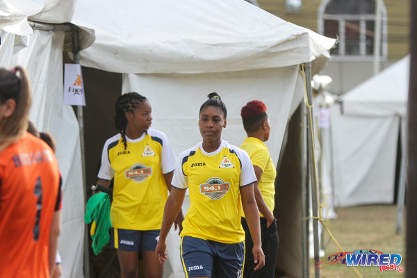 Photo: Fuego midfielder Jo-Marie Lewis (right) and her teammate emerge from the large tents that served as changing rooms for the WPL squads in St James. (Courtesy Sinead Peters/Wired868)
