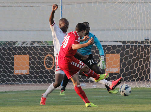 Photo: Jordan attacker Hamza Al Dardour (foreground) tries to shoot the ball past Trinidad and Tobago defender Daneil Cyrus and goalkeeper Jan-Michael Williams. (Courtesy TTFA Media)