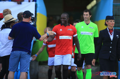 Photo: Manchester United star Dwight Yorke (centre) and goalkeeper Raymond van der Gouw prepare for action on day one of the BA Tobago Legends Football Tournament. (Courtesy Allan V Crane/Wired868)