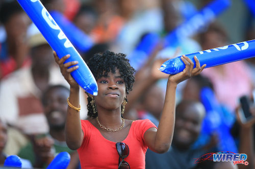Photo: A football fan enjoys the fun at the British Airways Tobago Legends Football Challenge at the Dwight Yorke Stadium, Bacolet. (Courtesy Allan V Crane/Wired868)