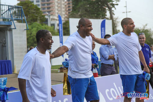 Photo: Russell Latapy,(left), Clayton Ince (middle) and Stan Collymore take part in the Legacy Community Outreach programme in Trinidad. (Courtesy Sinead Peters/Wired868)